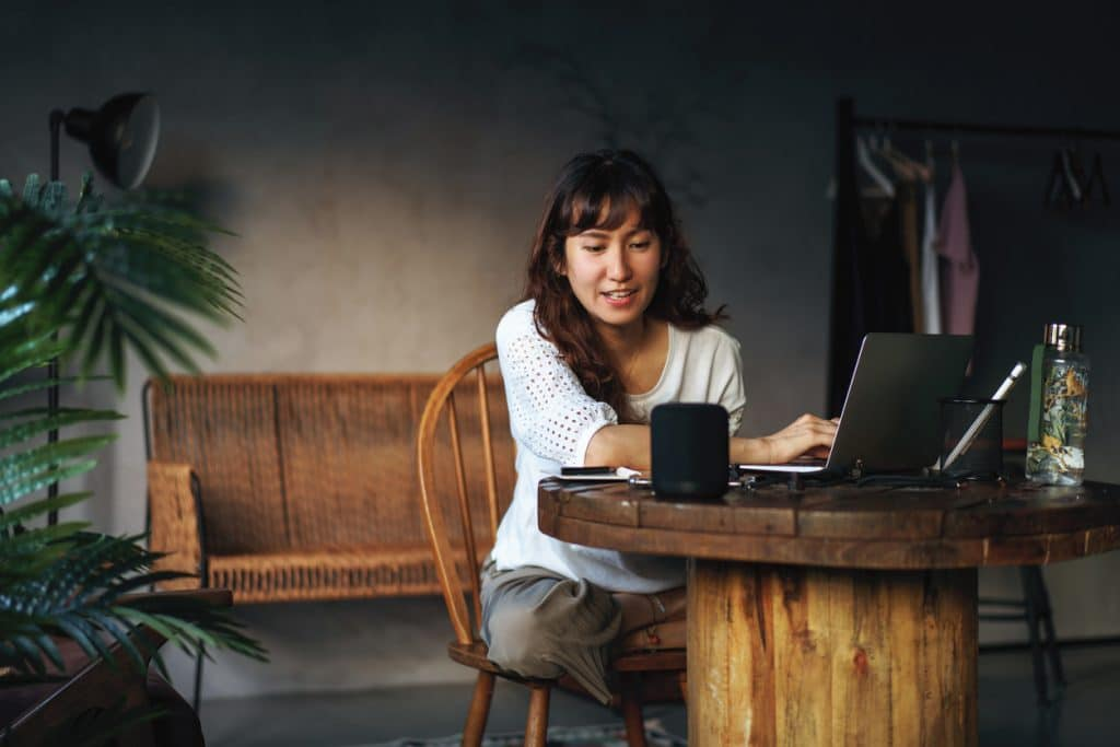 woman-working-with-smart-speaker